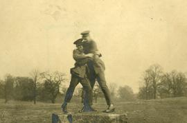 Two soldiers wrestling