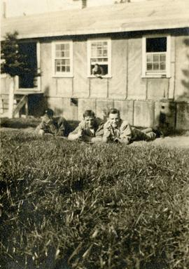 Soldiers lying in grass